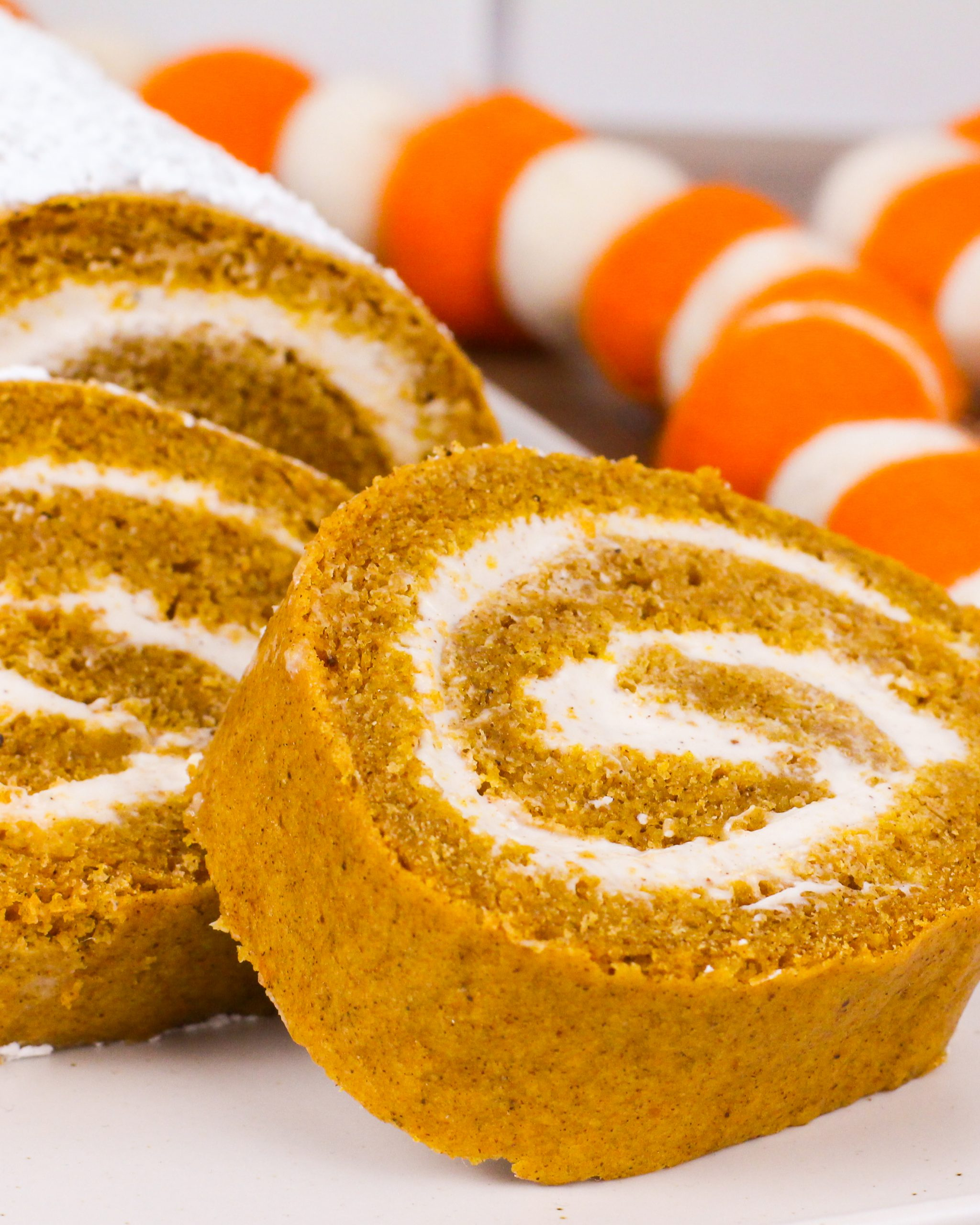 low sugar pumpkin roll with maple cream cheese frosting